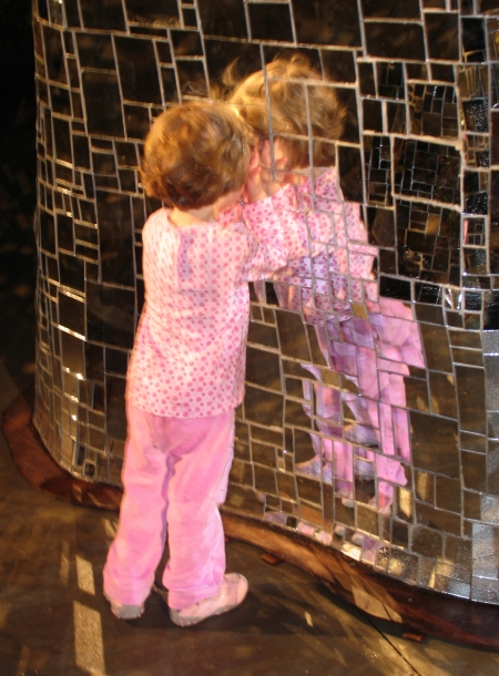 Don't strive Photo of a toddler girl in pink pyjamas leaning against a mirrored tiled wall
