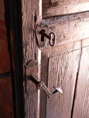 Love frees picture of open wooden door with a key in a heart shaped lock