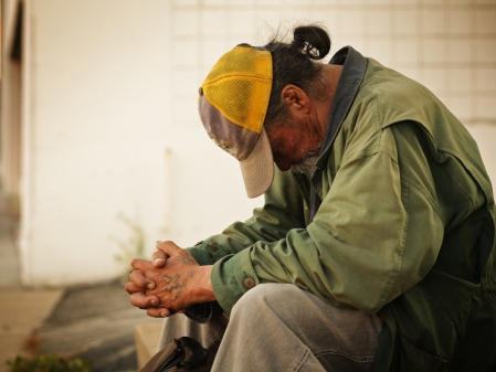 """Jesus said, """"As much as you do it for the least of these - you do it for me"""" Photo of homeless man dressed in green jacket, beige trousers and yellow cap with a pony tail from free photos on morguefiles"""