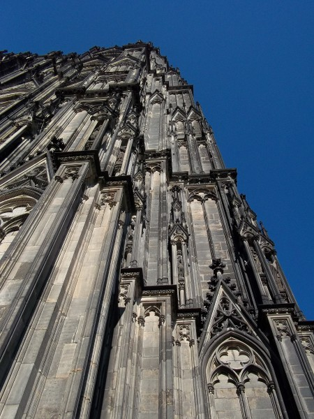 Photo of Cologne Cathedral from the outside against a dark royal blue sky