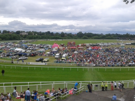 Chester Racecourse, thousands of people, funfair, horses