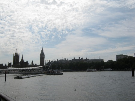 Photo of Thames River Cruise boat and pier with London skyline in the background on a beautiful summer's day