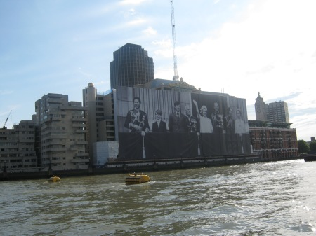 Photo of a hanging outside building of the royal family waving as seen from the River Thames boat cruise