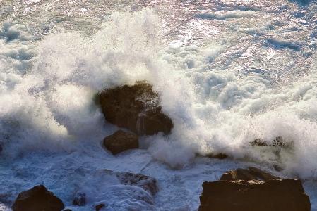 Photo of raging seas against rocks