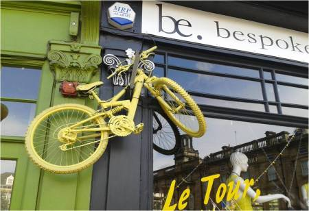 Photo of yellow bycycle on the wall of a shop called be bespoke in Harrogate July 2014