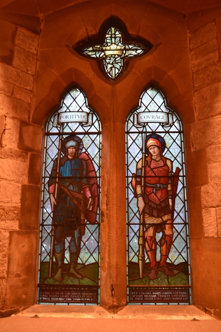 Photo of stained glass window in St Stephens church Tonbridge, two characters fortitude and courage