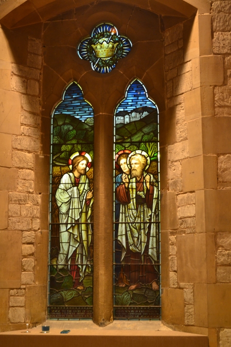 Photo of stained glass window at St Stephens Church, Tonbridge with Jesus and saints and crown of life suspended above them