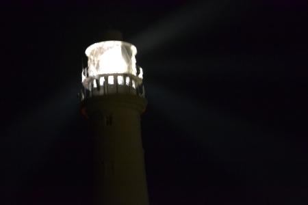 Flamborough lighthouse beaming its light at night