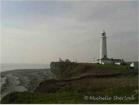 Nash Point Lighthouse standing tall and proud on the cliffs